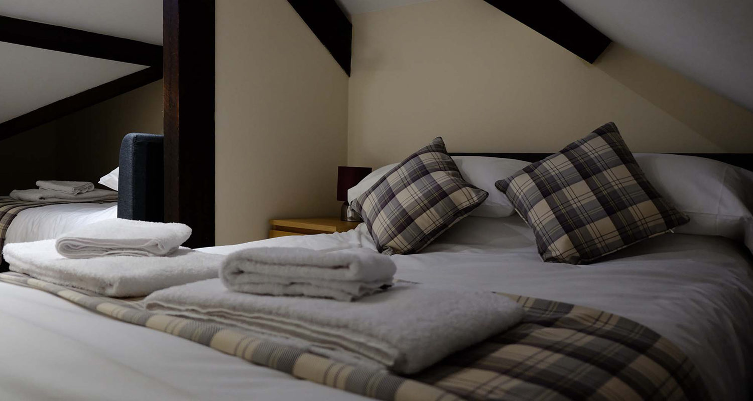 Bedroom double and single in the eaves at The Cwtch Mid Wales Holiday Lets Rhayader Elan Valley