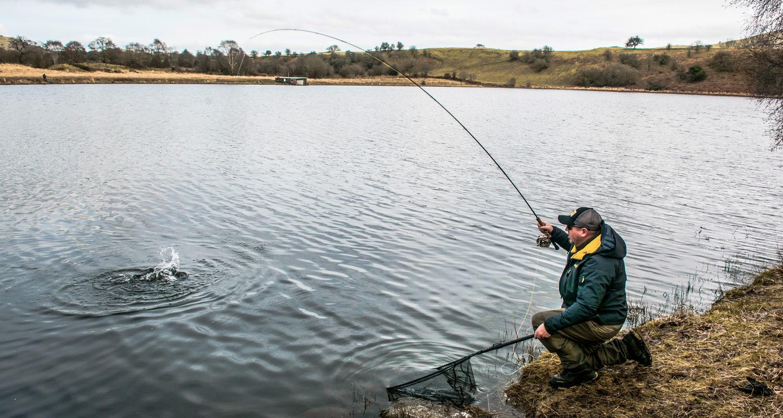 Llyngwyn landing a trout Fly Fishing Breaks at Mid Wales Holiday Lets Rhayader, Elan Valley Credit - fishingwalesnet